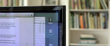 Computer in front of bookshelves
