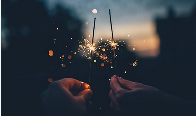 two golden sparklers at night