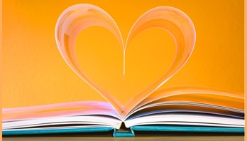 Book with pages bent to form a heart